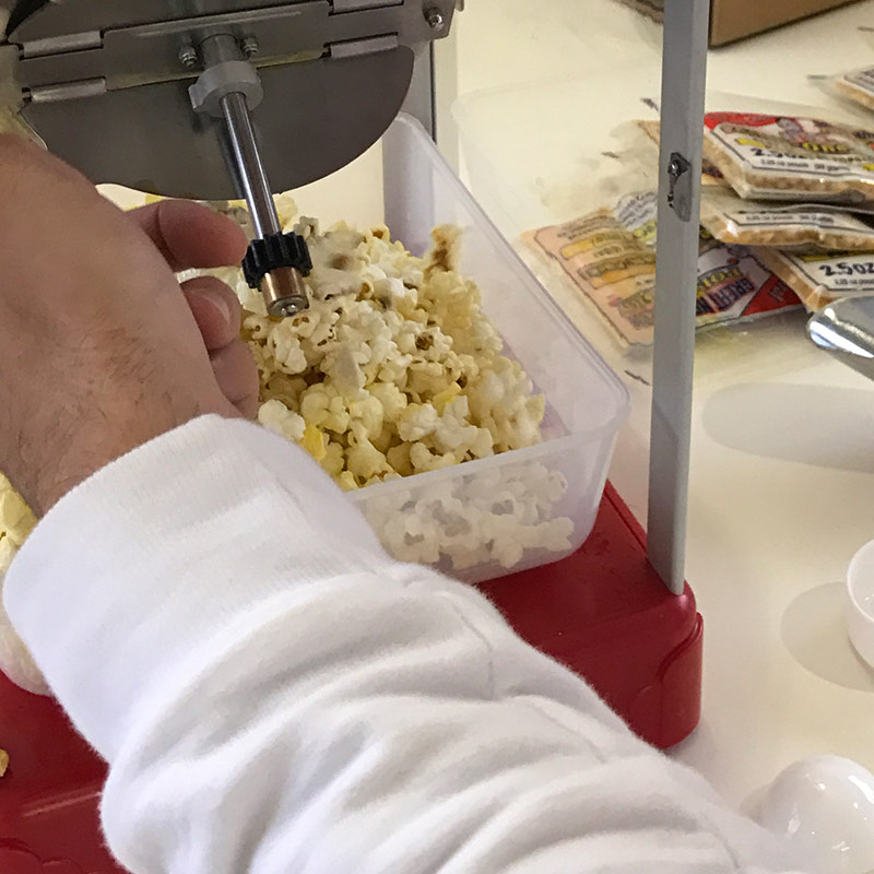 Popcorn machine popping popcorn