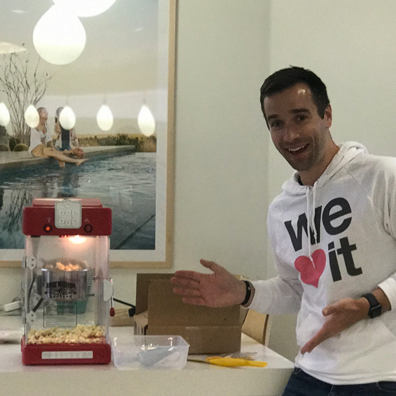 Stitch Fix employee presenting our new popcorn machine