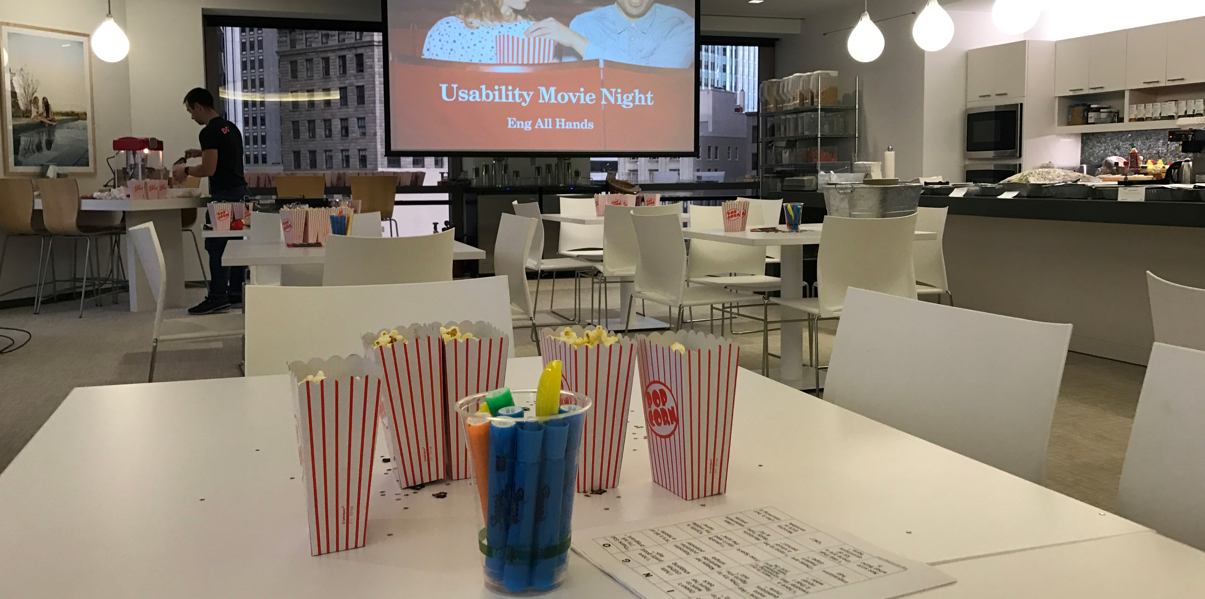 Stitch Fix cafe set up for movie night: Popcorn, bingo boards and markers on the tables.